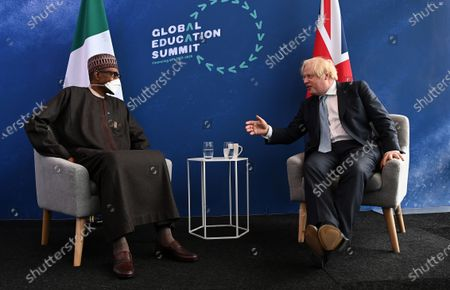 British Prime Minister Boris Johnson (R) during a meeting with President of Nigeria Muhammadu Buhari at the Global Education Summit in London, Britain, 29 July 2021. The UK and Kenya are hosting the Education Summit in London where leaders from world governments have come together to make pledges to support work to help transform education systems in up to 90 countries and territories.