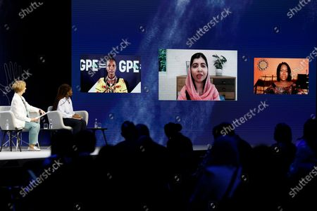 """Campaigner Malala Yousafzai, centre on screen, speaks via video link during a session entitled """"The Power of Education"""" on the second day of the Global Education Summit in London, hosted by Australia's former prime minister Julia Gillard, left"""