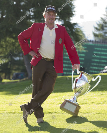 Miguel Angle Jimenez of Spain poses with the Omega European Masters trophy and wears the winners Red Jacket