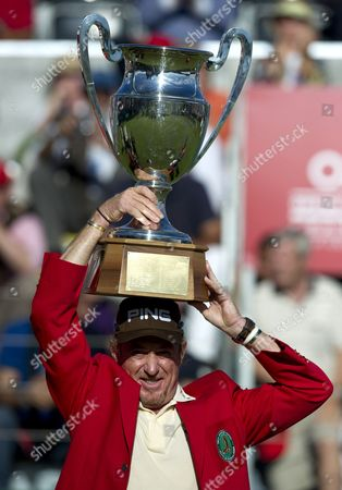 Miguel Angle Jimenez of Spain holds up the Omega European Masters trophy and wears the winners Red Jacket