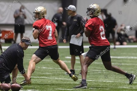 New Orleans Saints quarterbacks quarterback Taysom Hill (7) and Jameis Winston (2) run drills during NFL football training camp in Metairie