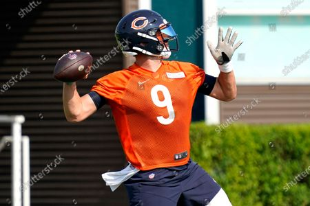 Stock Photo of Chicago Bears quarterback Nick Foles looks to pass during NFL football practice in Lake Forest, Ill