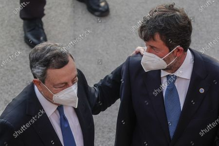Italian Minister of Culture Dario Franceschini (R) and Italian Prime Minister Mario Draghi, participate at the G20 meeting of the Ministers of Culture in the Colosseum, in Rome, Italy, 29 July 2021.