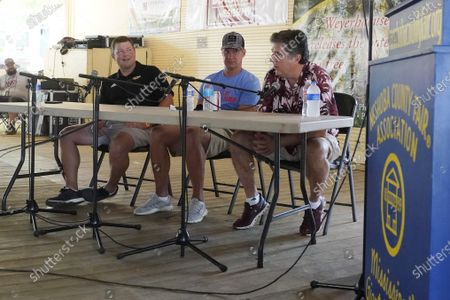 """Stock Photo of All three Mississippi NCAA Division 1 football coaches, from left, Will Hall of Southern Mississippi, Lane Kiffin of Mississippi, and Mike Leach of Mississippi State participated in a special """"Football at the Fair"""" program at the Neshoba County Fair in Philadelphia, Miss., . The fair, also known as Mississippi's Giant House Party, is an annual event of agricultural, political, and social entertainment at what might be the country's largest campground fair"""