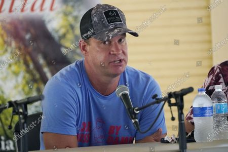 """Stock Picture of Mississippi football coach Lane Kiffin joined Will Hall of Southern Mississippi, and Mike Leach of Mississippi State, unseen, in participating in a special """"Football at the Fair"""" program at the Neshoba County Fair in Philadelphia, Miss., . The three Mississippi NCAA Division 1 football coaches discussed their programs' future, joked with each other and answered audience's questions in the hour long program. The fair, also known as Mississippi's Giant House Party, is an annual event of agricultural, political, and social entertainment at what might be the country's largest campground fair"""