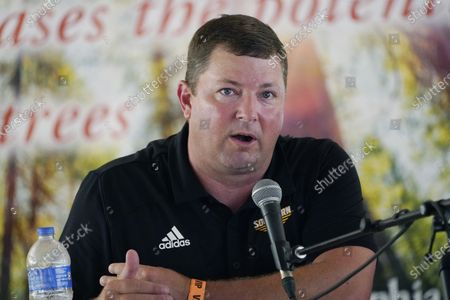 """Stock Image of Southern Mississippi football coach Will Hall joined Lane Kiffin of Mississippi, and Mike Leach of Mississippi State, unseen, in participating in a special """"Football at the Fair"""" program at the Neshoba County Fair in Philadelphia, Miss., . The three Mississippi NCAA Division 1 football coaches discussed their programs' future, joked with each other and answered audience's questions in the hour long program. The fair, also known as Mississippi's Giant House Party, is an annual event of agricultural, political, and social entertainment at what might be the country's largest campground fair"""