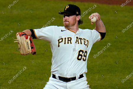 Pittsburgh Pirates first baseman John Nogowski pitches in relief during the ninth inning of the team's baseball game against the Milwaukee Brewers in Pittsburgh, . The Brewers won 12-0
