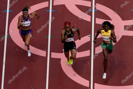 Shericka Jackson, of Jamaica, Michelle-Lee Ahye, of Trinidad and Tobago, and Jenna Prandini, of United States, compete during the first round of the women's 100-meter the 2020 Summer Olympics, in Tokyo