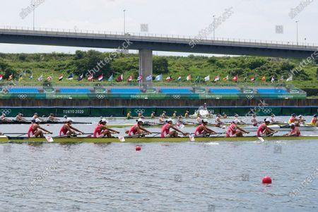 Wang Zifeng, Wang Yuwei, Xu Fei, Miao Tian, Zhang Min, Ju Rui, Li Jingjing, Guo Linlin, and Zhang Dechang of China compete in the women's rowing eight final at the 2020 Summer Olympics, in Tokyo, Japan