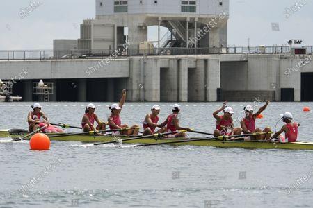 Stock Picture of Wang Zifeng, Wang Yuwei, Xu Fei, Miao Tian, Zhang Min, Ju Rui, Li Jingjing, Guo Linlin, and Zhang Dechang of China react after competing in the women's rowing eight final at the 2020 Summer Olympics, in Tokyo, Japan
