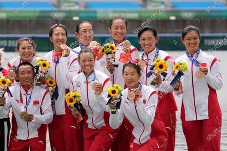 Wang Zifeng, Wang Yuwei, Xu Fei, Miao Tian, Zhang Min, Ju Rui, Li Jingjing, Guo Linlin, and Zhang Dechang of China pose for the photographers during the medal ceremony in the women's rowing eight final at the 2020 Summer Olympics, in Tokyo, Japan