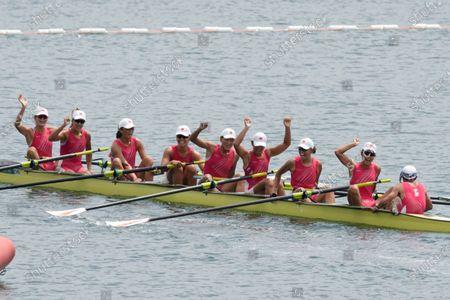 Stock Photo of Wang Zifeng, Wang Yuwei, Xu Fei, Miao Tian, Zhang Min, Ju Rui, Li Jingjing, Guo Linlin, and Zhang Dechang of China celebrate winning the bronze medal in the women's rowing eight final at the 2020 Summer Olympics, in Tokyo, Japan
