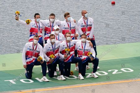 Stock Image of Josh Bugajski, Jacob Dawson, Tom George, Mohamed Sbihi, Charles Elwes, Oliver Wynne-Griffith, James Rudkin, Tom Ford, and Henry Fieldman, of Britain pose after winning the bronze medal in the men's rowing eight final at the 2020 Summer Olympics, in Tokyo, Japan