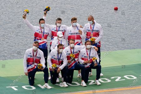 Stock Photo of Josh Bugajski, Jacob Dawson, Tom George, Mohamed Sbihi, Charles Elwes, Oliver Wynne-Griffith, James Rudkin, Tom Ford, and Henry Fieldman, of Britain pose after winning the bronze medal in the men's rowing eight final at the 2020 Summer Olympics, in Tokyo, Japan