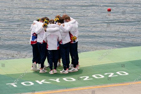 Josh Bugajski, Jacob Dawson, Tom George, Mohamed Sbihi, Charles Elwes, Oliver Wynne-Griffith, James Rudkin, Tom Ford, and Henry Fieldman, of Britain celebrate winning the bronze medal in the men's rowing eight final at the 2020 Summer Olympics, in Tokyo, Japan