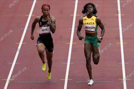 Michelle-Lee Ahye, left, of Trinidad and Tobago, wins a heat in the women's 100-meter run at the 2020 Summer Olympics, in Tokyo