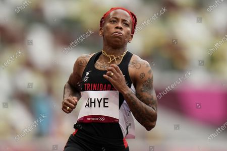 Michelle-Lee Ahye, of Trinidad and Tobago, wins a heat in the women's 100-meter run at the 2020 Summer Olympics, in Tokyo