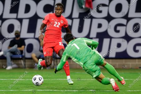 Canada defender Richie Laryea (22) attempts a shot on goal as Mexico goalkeeper Alfredo Talavera (1) dives for the save during the first half of a CONCACAF Gold Cup soccer semifinal, in Houston