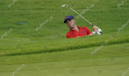 Justin Thomas of United States watches his bunker shot on the 12th hole during the second round of the men's golf event at the 2020 Summer Olympics, at the Kasumigaseki Country Club in Kawagoe, Japan