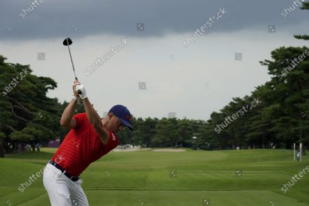 Stock Photo of Justin Thomas of United States hits a tee shot on the 18th hole during the second round of the men's golf event at the 2020 Summer Olympics, at the Kasumigaseki Country Club in Kawagoe, Japan