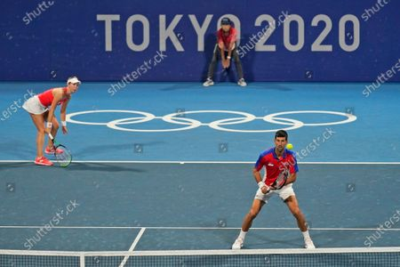 Stock Photo of The Serbian mixed doubles team of Novak Djokovic, right, and Nina Stojanovic play during the semifinals of the tennis competition at the 2020 Summer Olympics, in Tokyo, Japan