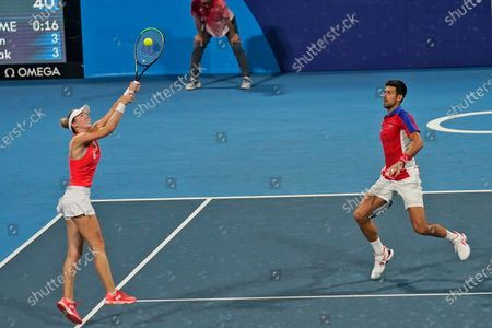 Stock Picture of The Serbian mixed doubles team of Novak Djokovic, right, and Nina Stojanovic play during the semifinals of the tennis competition at the 2020 Summer Olympics, in Tokyo, Japan