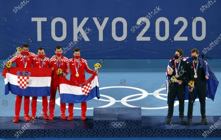 Golden medalists Mate Pavic (3-L) and Nikola Mektic (4-L) of Croatia and silver medalists Marin Cilic (L) and Ivan Dodig (2-L) of Croatia and bronze medallists Marcus Daniell and Michael Venus New Zealand celebrate on the podium after the Men's Doubles Gold Medal match, Tennis events of the Tokyo 2020 Olympic Games at the Ariake Coliseum in Tokyo, Japan, 30 July 2021.