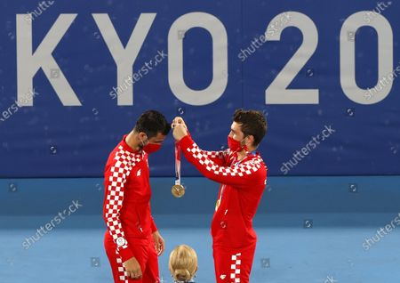 Matepavic and Nikola Mektic of Croatia celebrate gold medal on the podium after winning the Men's Doubles Gold Medal match, Tennis events of the Tokyo 2020 Olympic Games at the Ariake Coliseum in Tokyo, Japan, 30 July 2021.