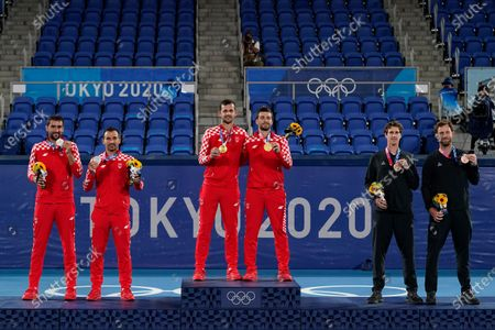 Silver medalists Marin Cilic and Ivan Dodig, from left, of Croatia, gold medalists Mate Pavic, and Nikola Mektic, of Croatia, and bronze medalists Michael Venus and Marcus Daniell, of New Zealand, pose with their medals during a ceremony for the men's doubles tennis competition at the 2020 Summer Olympics, in Tokyo, Japan