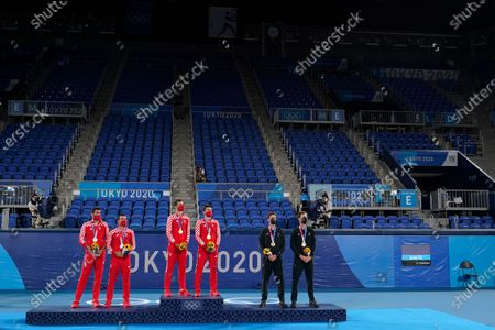 Silver medalists Marin Cilic and Ivan Dodig, from left, of Croatia, gold medalists Mate Pavic and Nikola Mektic, of Croatia, and bronze medalists Michael Venus and Marcus Daniell, of New Zealand, stand for the Croatian national anthem during a ceremony for the men's doubles tennis competition at the 2020 Summer Olympics, in Tokyo, Japan