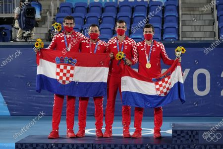 Silver medalists Marin Cilic, left, and Ivan Dodig, of Croatia, and gold medalists Mate Pavic, second from right, and Nikola Mektic, of Croatia, pose with their medals during a ceremony for the men's doubles tennis competition at the 2020 Summer Olympics, in Tokyo, Japan