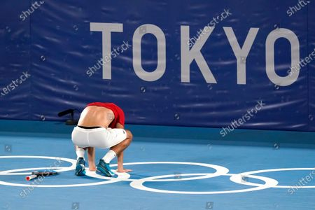 Mate Pavic, of Croatia, reacts after he and teammate Nikola Mektic defeated Ivan Dodig Marin Cilic, of Croatia, during the final round of the men's doubles tennis competition at the 2020 Summer Olympics, in Tokyo, Japan