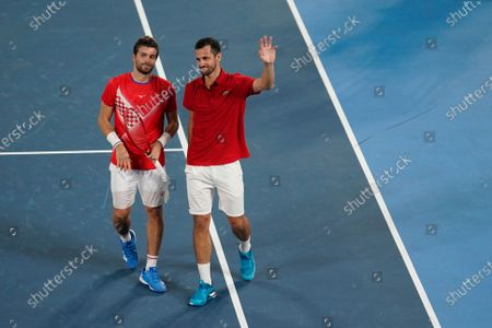 Nikola Mektic, left, and Mate Pavic, of Croatia, react after defeating Ivan Dodig and Marin Cilic, of Croatia, during the final round of the men's doubles tennis competition at the 2020 Summer Olympics, in Tokyo, Japan
