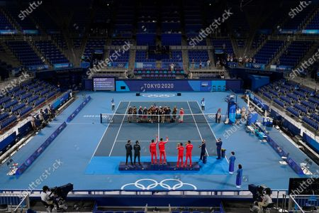 Bronze medalists Marcus Daniell and Michael Venus, from left, of New Zealand, gold medalists Nikola Mektic and Mate Pavic, of Croatia, and silver medalists Ivan Dodig and Marin Cilic, of Croatia, pose with their medals during a ceremony for the men's doubles tennis competition at the 2020 Summer Olympics, in Tokyo, Japan