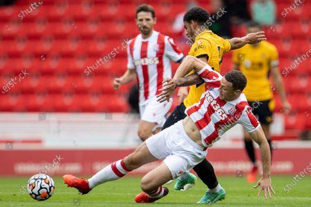 James Chester of Stoke City tackles Morgan Gibbs-White of Wolverhampton Wanderers; Bet365 Stadium, Stoke, Staffordshire, England; Pre Season Friendly Football, Stoke City versus Wolverhampton Wanderers.