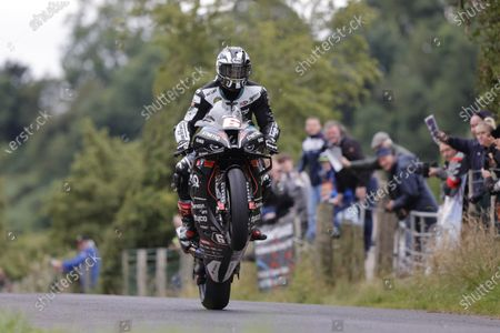Stock Picture of The fans applaud Michael Dunlop (TAS Racing Synetic BMW) on winning the feature SuperBike race - The Race of Legends; Armoy, Antrim, Northern Ireland; Armoy Road Races, The Race of Legends Motor Cycling, Day Two.
