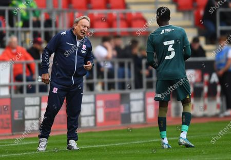 Stock Picture of Neil Warnock manager of Middlesbrough talks to Isaiah Jones of Middlesbrough