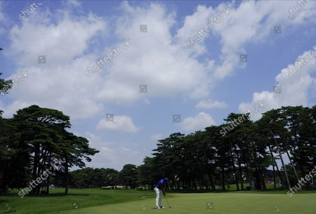 Jhonattan Vegas of Venezuela makes a putt on the third hole during the third round of the men's golf event at the 2020 Summer Olympics, in Kawagoe, Japan
