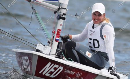 Stock Photo of Marit Bouwmeester of the Netherlands smiles as she qualified in second position for the Medal race of the Women's Laser Radial Class during the Sailing events of the Tokyo 2020 Olympic Games in Enoshima, Japan, 30 July 2021.