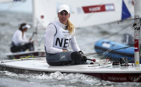 Marit Bouwmeester of the Netherlands smiles as she qualified in second position for the Medal race of the Women's Laser Radial Class during the Sailing events of the Tokyo 2020 Olympic Games in Enoshima, Japan, 30 July 2021.