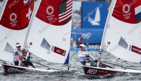 Marit Bouwmeester of the Netherlands (R) and Paige Railey of the USA (L) compete in the Women's Laser Radial Class during the Sailing events of the Tokyo 2020 Olympic Games in Enoshima, Japan, 30 July 2021.