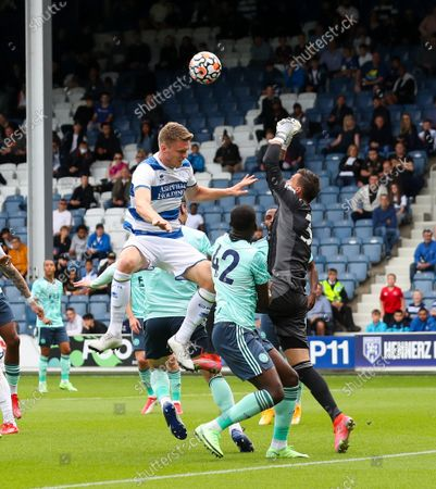 Stock Image of Rob Dickie of QPR  tries to beat Eldin Jakupovic goalkeeper of Leicester City to a cross