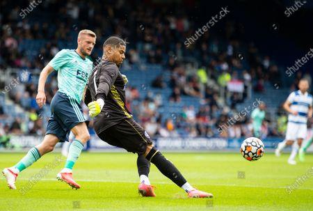 Seny Dieng goalkeeper of QPR and Jamie Vardy of Leicester City