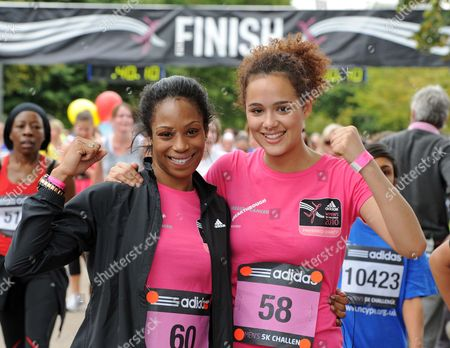 Stock Picture of Eastenders star Simone James and Hollyoaks actress Nathalie Emmanuel celebrate finishing the Adidas Women's 5K Challenge in support of Breakthrough Breast Cancer