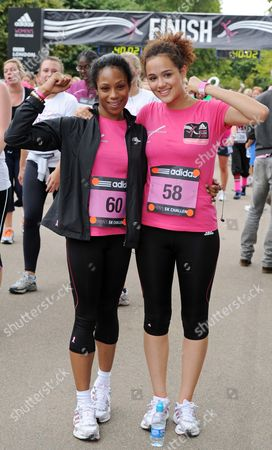 Stock Photo of Eastenders star Simone James and Hollyoaks actress Nathalie Emmanuel celebrate finishing the Adidas Women's 5K Challenge in support of Breakthrough Breast Cancer