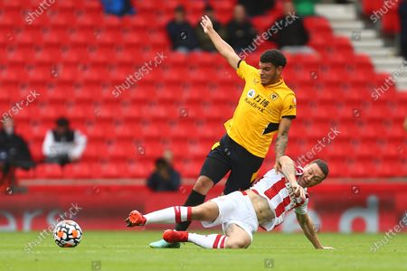 Stock Picture of Stoke's James Chester tackles Wolves' Morgan Gibbs-White