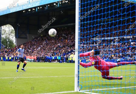 Stock Photo of Huddersfield Town goalkeeper Lee Nicholls saves a penalty kick from Massimo Luongo of Sheffield Wednesday