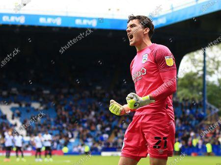 Huddersfield Town goalkeeper Lee Nicholls celebrates saving a penalty kick from Massimo Luongo of Sheffield Wednesday