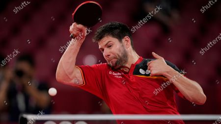 Dimitrij Ovtcharov of Germany hits the ball during a bronze medal match of the table tennis men's singles against Lin Yun-ju of Taiwan, at the 2020 Summer Olympics, in Tokyo