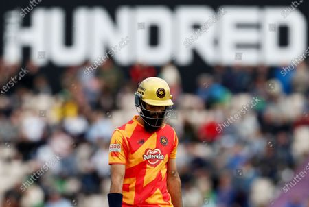 Stock Picture of Moeen Ali of Birmingham Phoenix leaves the field after being bowled out by Jake Lintott of Southern Brave.